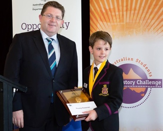 Photo: 2014 Young Historian of the Year, Angus Christie (Year 5) and Senator the Honourable Scott Ryan, Parliamentary Secretary to the Minister for Education. Photo: Steve Keough.